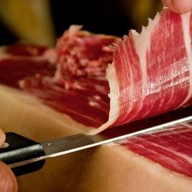 Cutting knife and vacuum packed Iberian ham